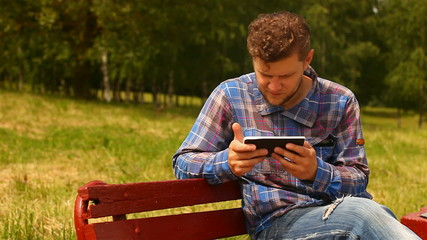 Young man with tablet computer.