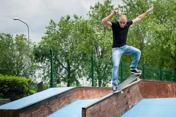 Skateboarder doing a skateboard trick at skatepark.