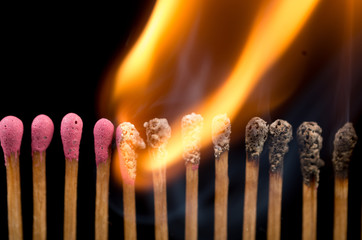 Burning matches in a line