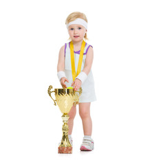 Portrait of baby in tennis clothes with medal and goblet