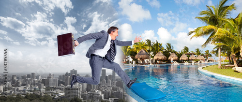 canvas print picture Businessman jumping on the water.