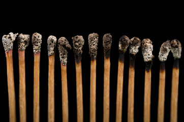 New and burnt matches, close-up, black background