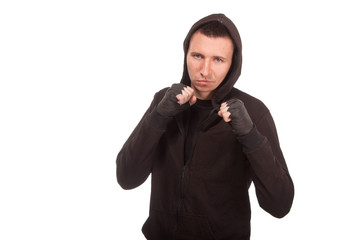 Young man in a hoodie standing in a fighting stance