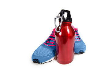 Water bottle with running shoes, exercise and hydration concept