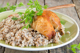 buckwheat in a wooden plate with chicken.