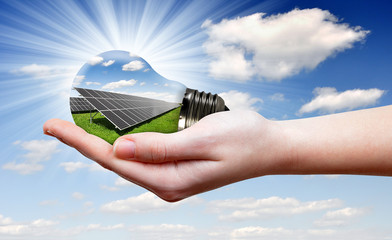 Bulb with of solar panel in hand