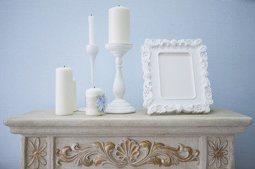 candlesticks and picture frame