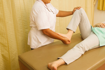 Physiotherapist treating quadriceps muscle,Rehabitation  for mus
