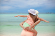 Young beautiful mother and her little daughter have fun at the