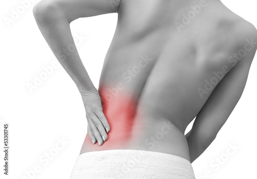 Woman holding hand her back in sport pain isolated on white