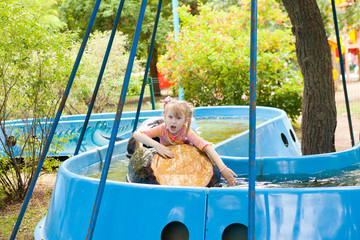 child in the boat in the park