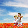 Happy couple on poppies field