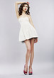 Elegance. Stylish Brunette in Light Sundress. Fashion Style