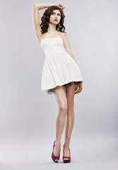 Elegance. Stylish Brunette in Light Sundress. Fashion Style