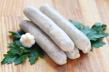 Raw chicken sausages with parsley