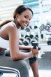 Gym woman exercising with weights