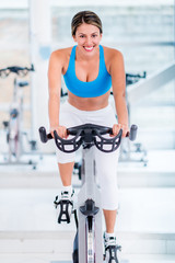 Gym woman doing spinning