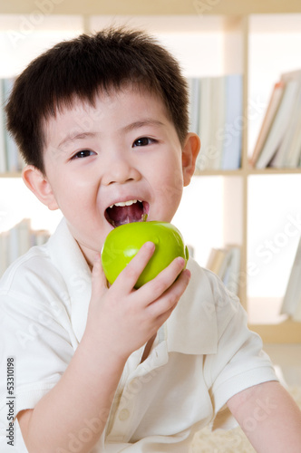 asian boy eating apple