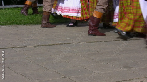 Lithuanian folk dance group performing outdoors