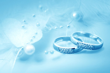 Wedding rings, card in blue color
