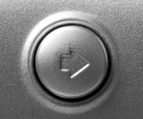 close up of button with arrow right