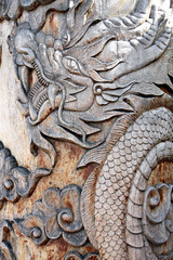 Pictures dragon carved from wood.