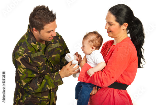 Mother and baby welcoming army dad