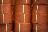 Close up of rolls of red polyester rope poster