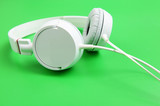 Headphone over green background