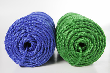 Rolls of green and blue polyester rope - close up