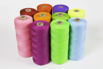 Rolls of colorful polyester rope - close up.