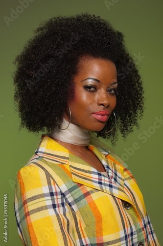 Afro woman in vintage seventies fashion style. Yellow jacket and