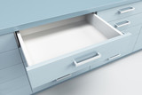 cupboard with opened drawer