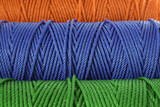 Rolls of green, blue and red polyester rope - close up poster