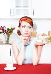 Sad beautiful woman looking on cake