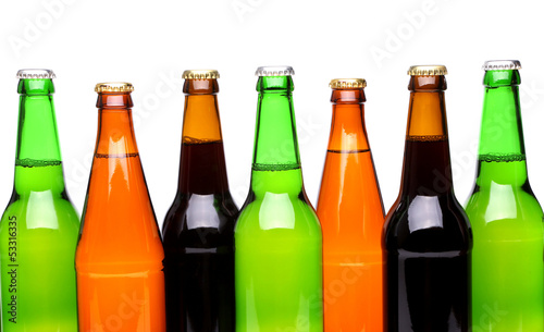 A row of top beer bottles