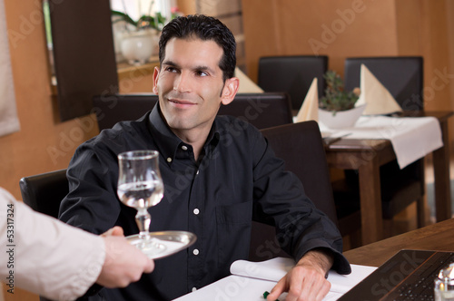 Businessman gets Glass of Water