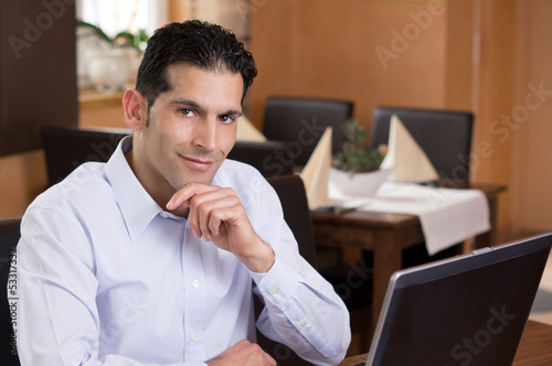 Friendly Businessman working in Restaurant