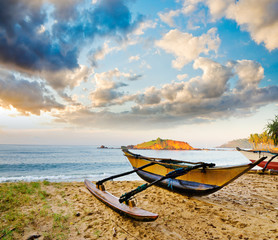 fishing boat  against sunset background