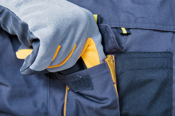 Repairman adjusting his working overalls