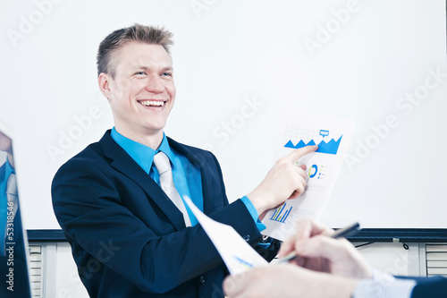 Businessman in meeting presenting sales report