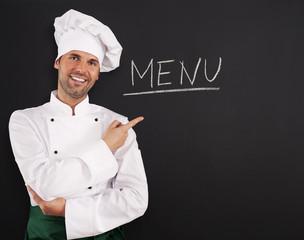 Handsome chef showing menu