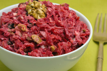 Salad with beets, dried plums, nuts