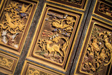 Animals carved into wooden door at temple