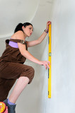 Woman finding a straight line spirit level