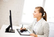 businesswoman with drawing tablet in office