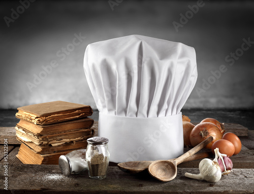 cooking books and white cap