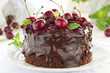 Chocolate cake with cherries and chocolate cream.