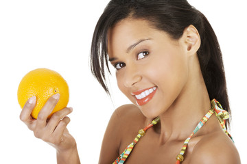 Happy summer woman in bikini with oranges.