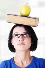 Student with an apple and book